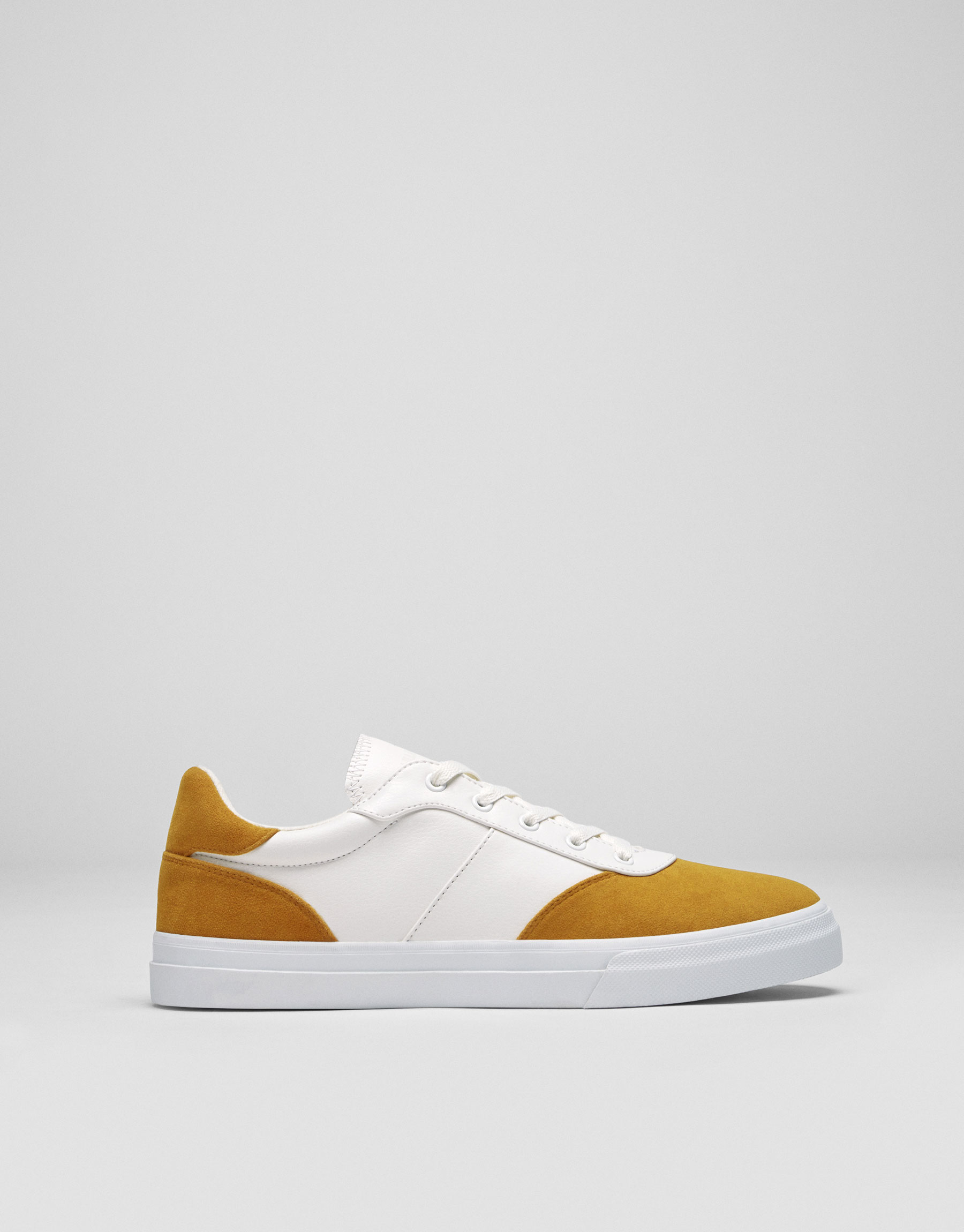 Two-tone yellow plimsolls