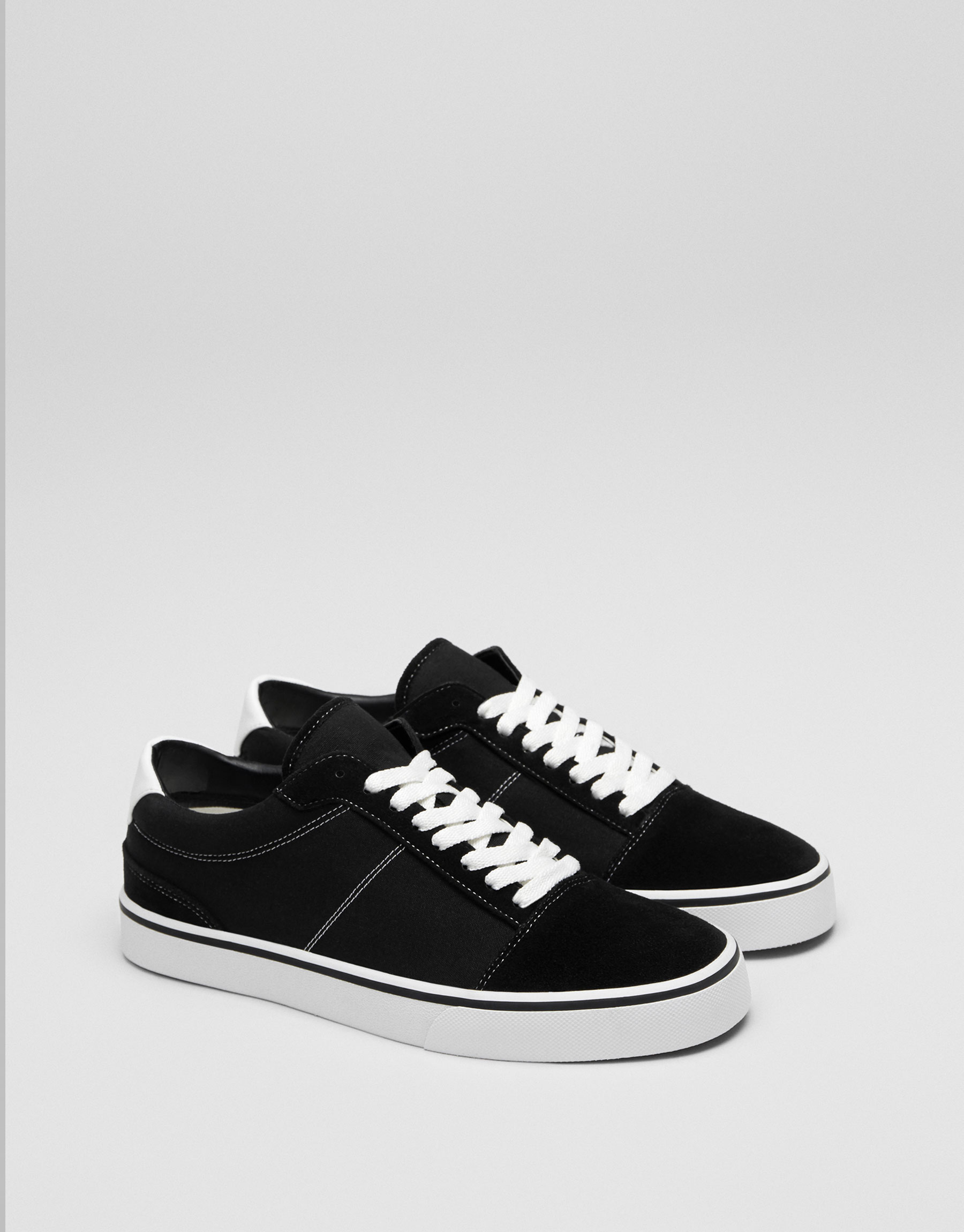 Black university plimsolls