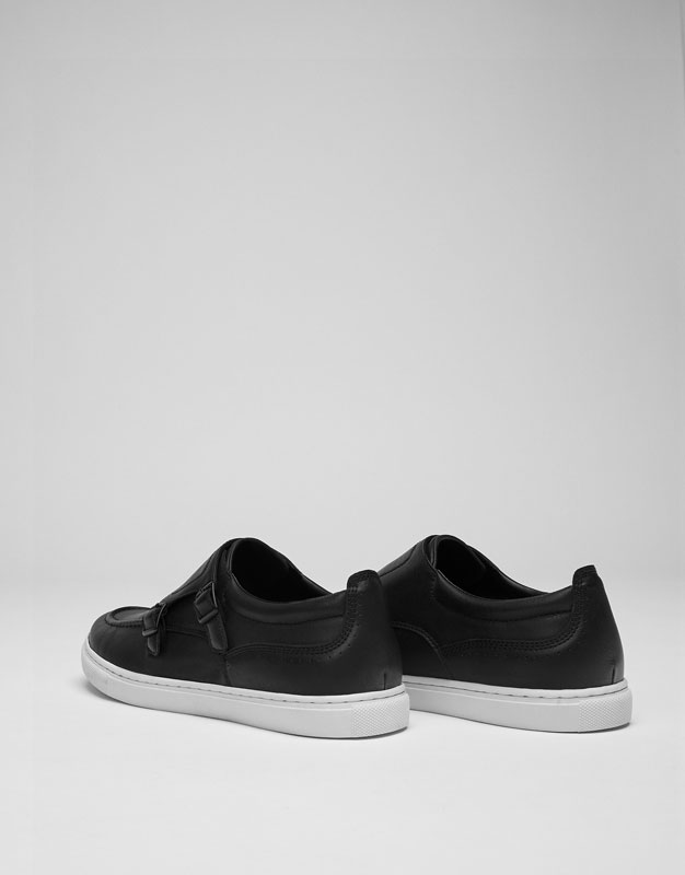 Buckled plimsolls
