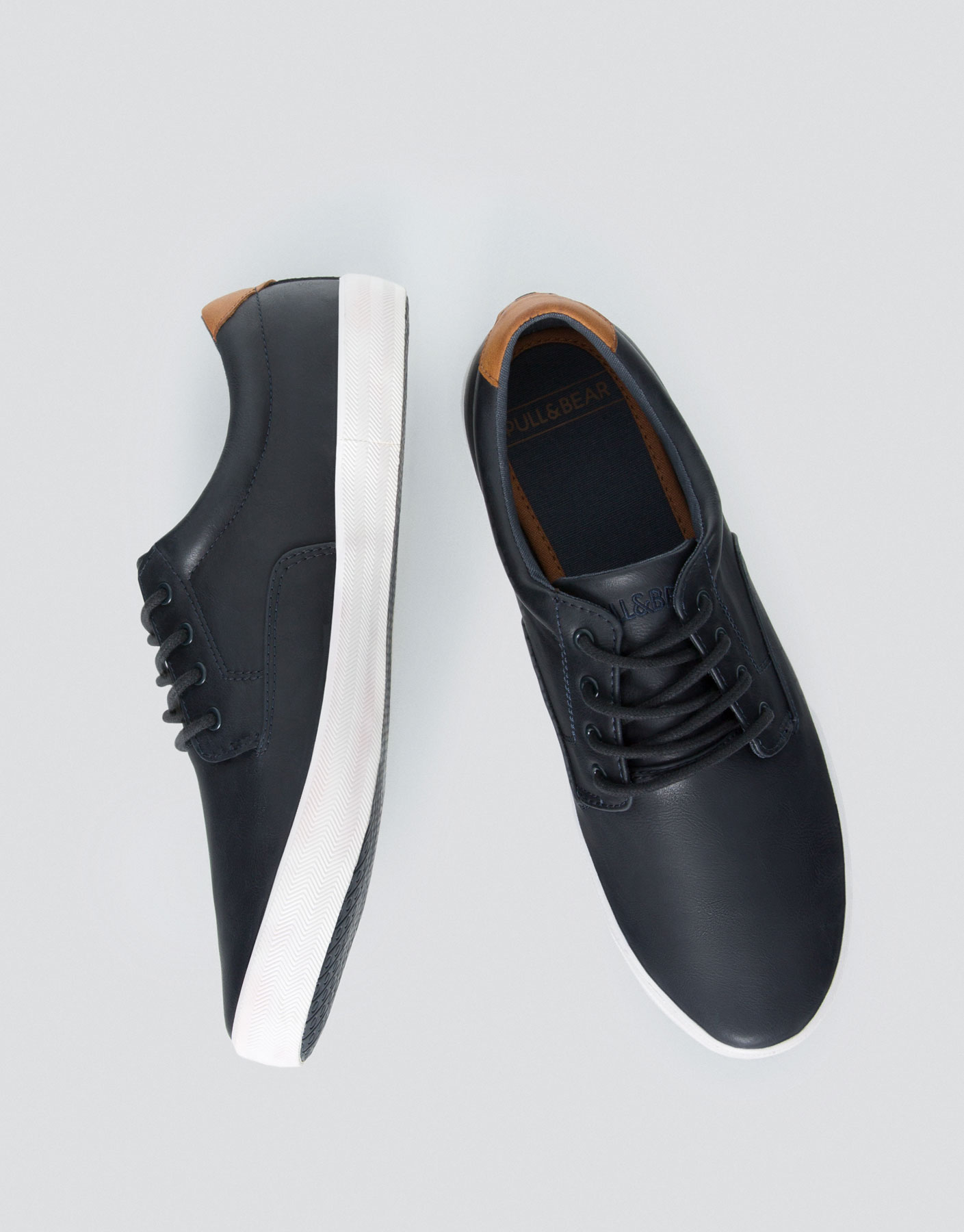 Smart blue plimsolls