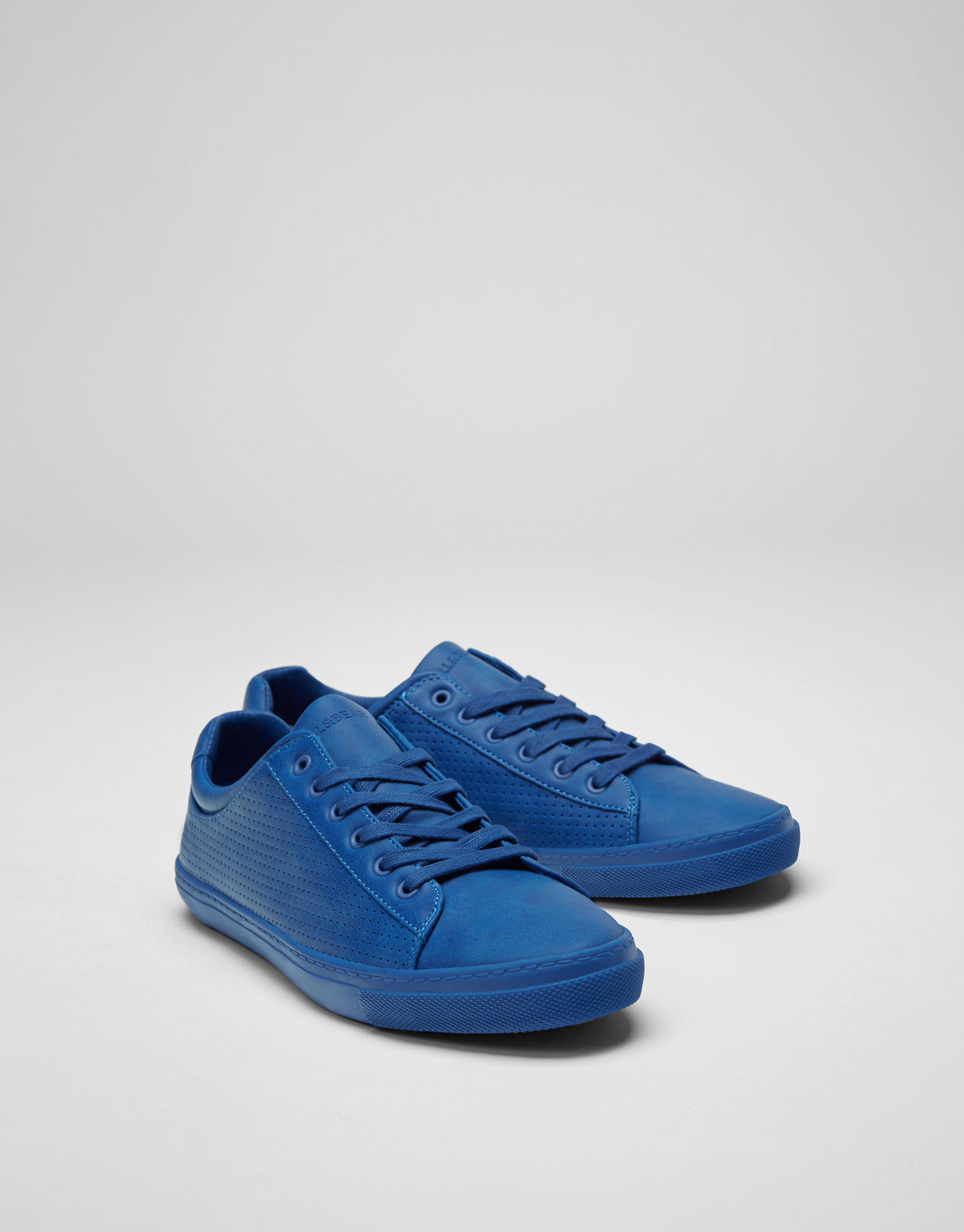 Blue colour block plimsolls with brogueing