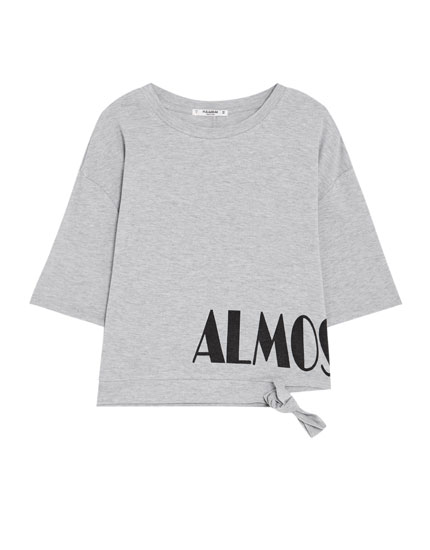 Cropped T-shirt with slogan and cut-out details