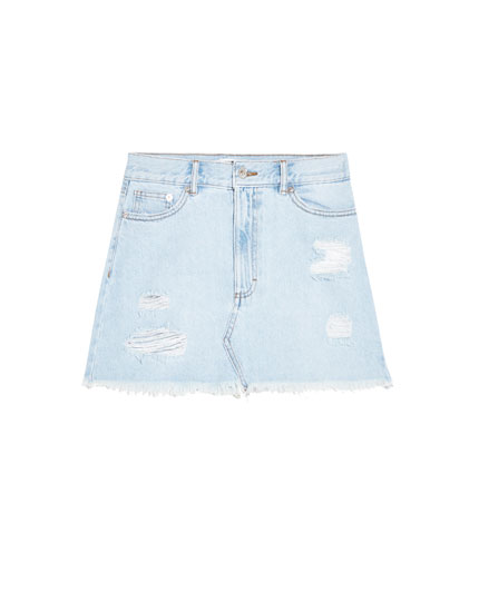 Short ripped denim skirt