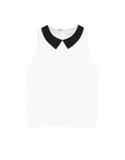 Sleeveless top with a shirt collar