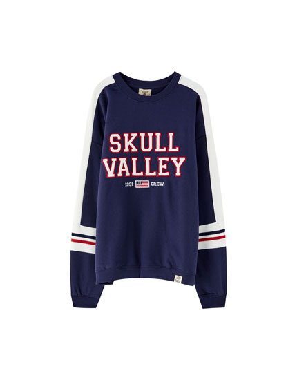 College sweatshirt with striped sleeves
