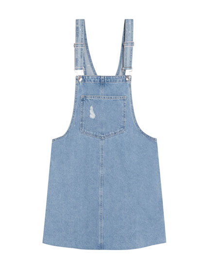 Denim pinafore dress with unfinished hem