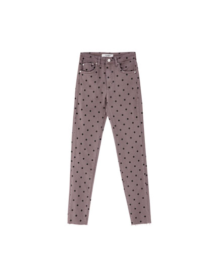 Skinny jeans with pindot print