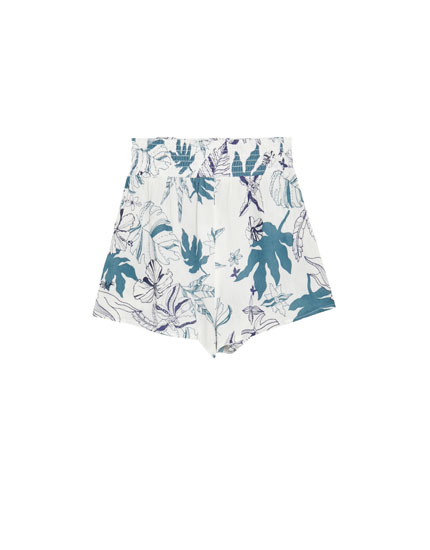 Flared shorts with a floral print