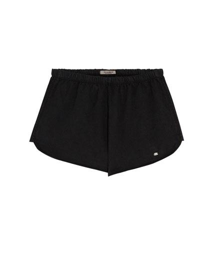 Pantalons curts bàsics colors