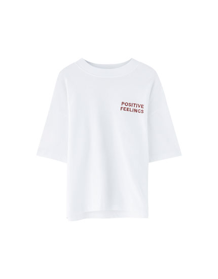 White T-shirt with embroidered slogan