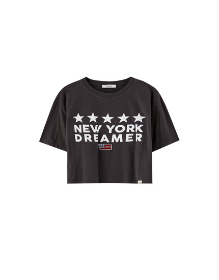 Cropped T-shirt with slogan and flag
