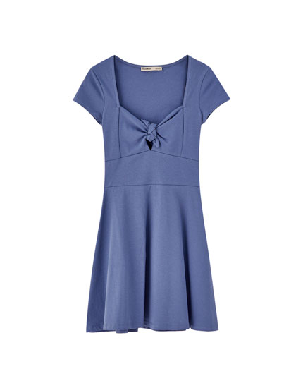 Dress with bow at neckline