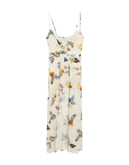 Printed jumpsuit with overskirt and knot