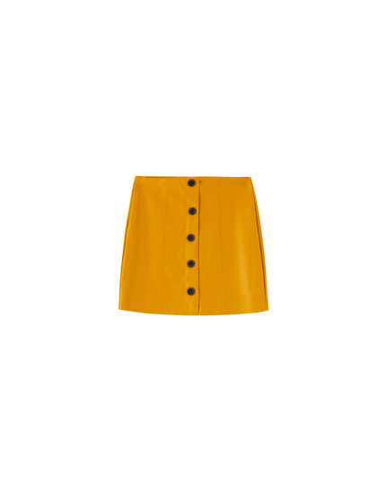 Mustard yellow faux leather mini skirt