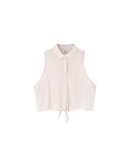 Plain sleeveless shirt with knot