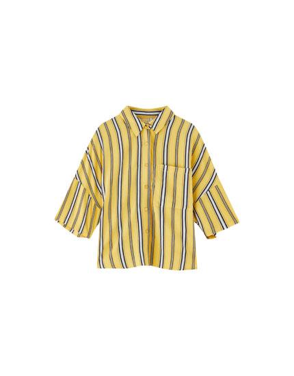Vienkāršs 'oversize' stila krekls ar apdruku