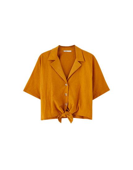 Krekls ar atloku apkakli un mezglu