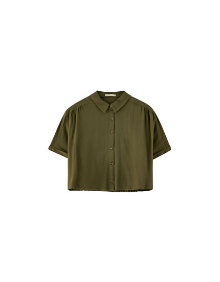 Shirt with elasticated back
