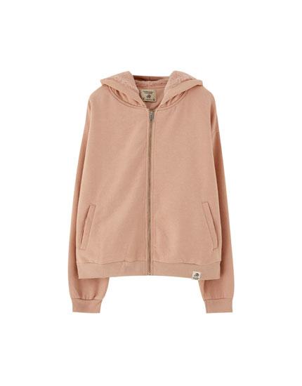 Sweatshirt i imiteret pels med hætte