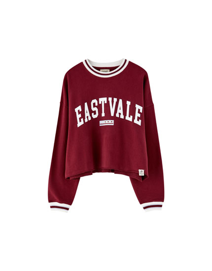 Oversized college sweater met tekst