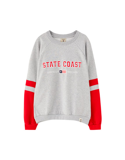 Grey varsity sweatshirt with contrasting sleeves