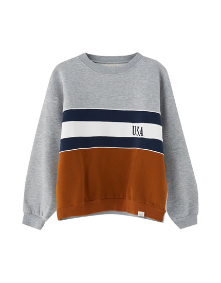 Grey varsity sweatshirt with ochre panel