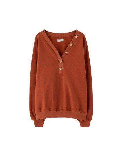 Sweatshirt aus Baumwolle mit Knöpfen