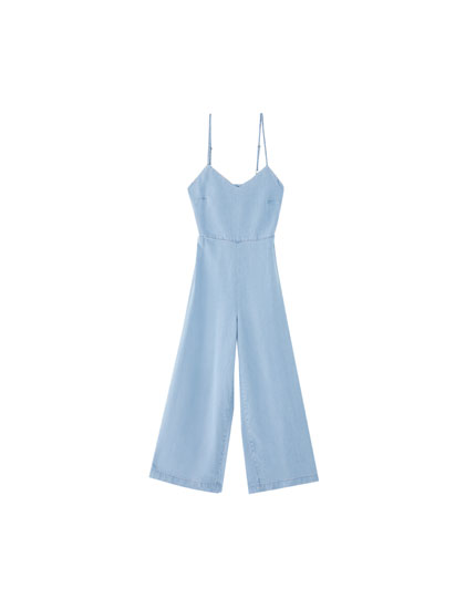 Long denim jumpsuit with a knot on the back
