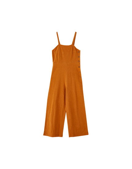 Long jumpsuit with side buttons