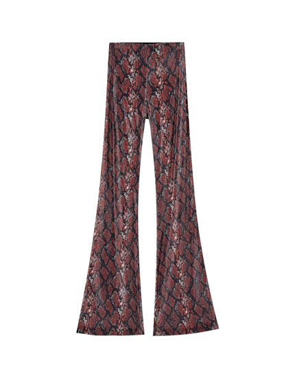 Sequinned snakeskin print flared trousers