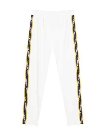 White jogging trousers with side taping