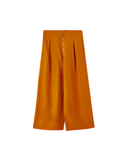 Ochre culottes with buttons