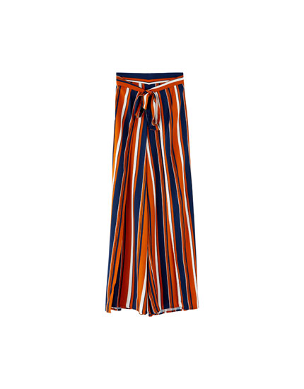 Striped trousers with side slit