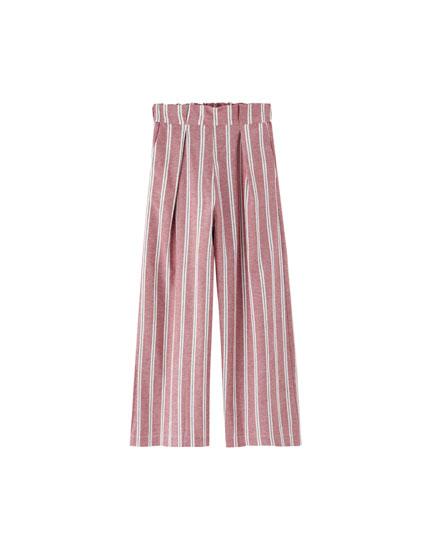 Pantaloni culottes cu pense