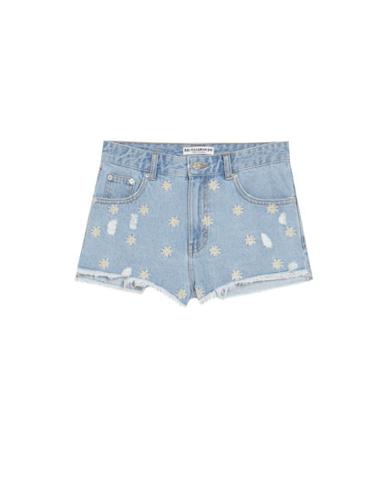 Calções denim mom fit margaridas