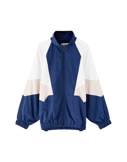Windbreaker with coloured panels