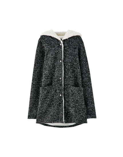 Knitted coat with hood