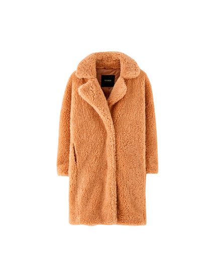 Long ochre faux fur coat