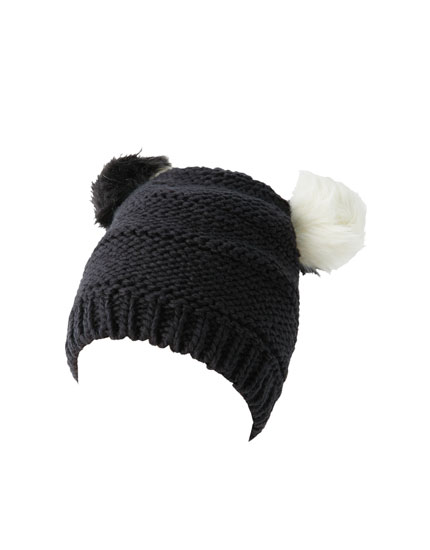 Hat with 2 black and white pompoms