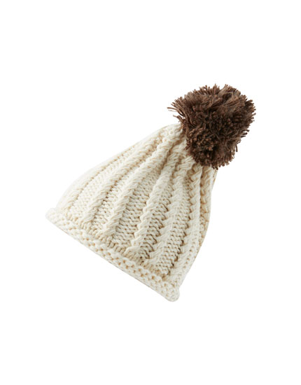 Textured knit hat with pompom