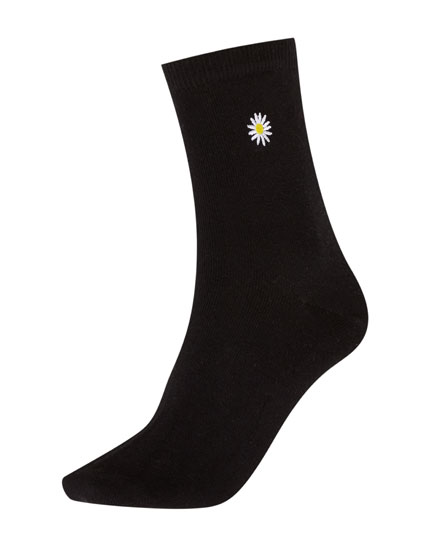 Socks with embroidered daisy