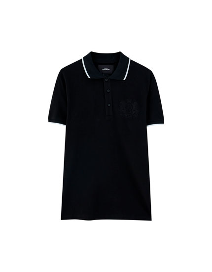 Polo shirt with embroidered coat of arms
