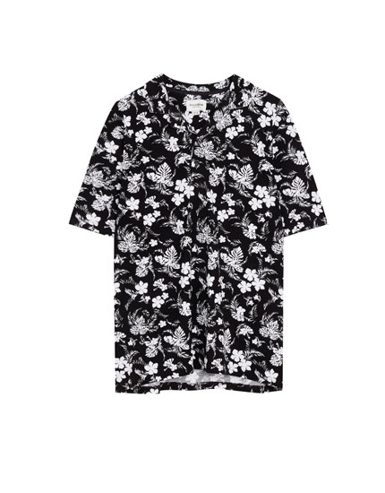 Polo met bloemenprint all-over