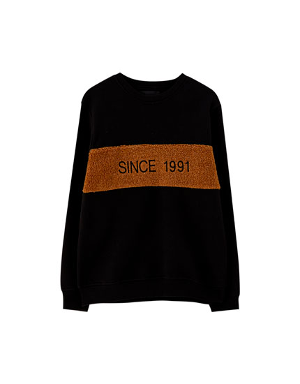 Sweatshirt with faux shearling panel