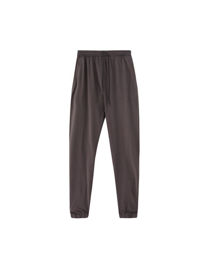Faded jogging trousers