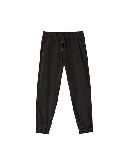 Dark-coloured beach trousers