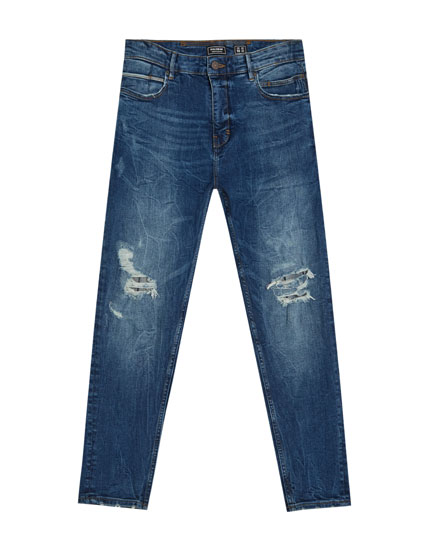 Jeans carrot fit descosidos