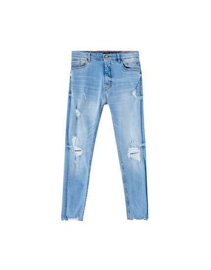 Distressed premium carrot fit jeans