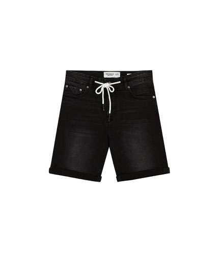 Black skinny denim Bermuda shorts