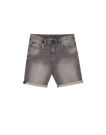 Distressed effect denim Bermuda shorts